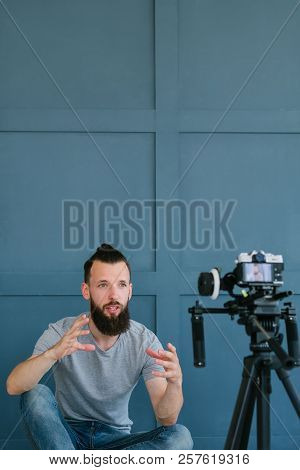 Social Media Influencer Creating Content. Man Shooting Video Of Himself Using Camera On Tripod. Blog