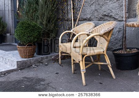Armchairs Made Of Straw. Rural Chairs. Chairs On The Street. Two Straw Chairs.