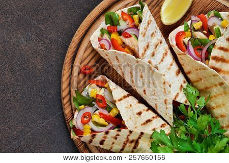 Taco -  Traditional Dish Of Mexican Cuisine. Mexican Tacos With Beef, Vegetables And Sauce. Top View