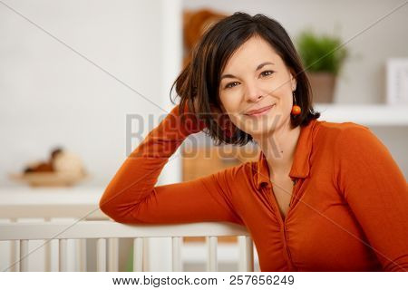 Portrait of happy young woman at home.