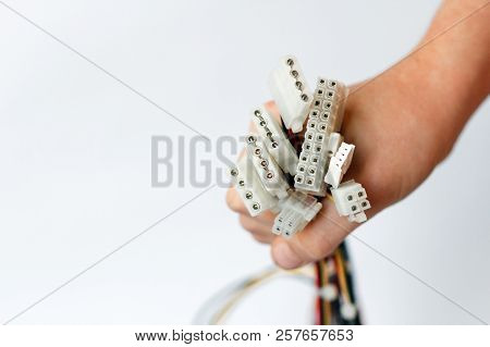Hand Holds Power Cables From Power Supply Unit On White Background, Pc Motherboard Power Cables And
