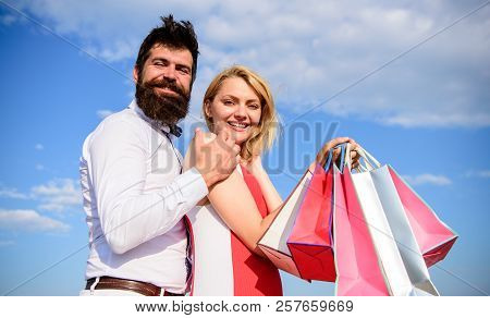 Family Bought Excellent Clothes. Couple With Luxury Bags Hugs Blue Sky Background. Happy Couple Luxu