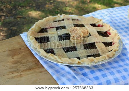 A Blueberry Pie Ready To Be Baked In The Oven.