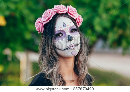 Closeup Portrait Of Calavera Catrina. Young Woman With Sugar Skull Makeup. Dia De Los Muertos. Day O