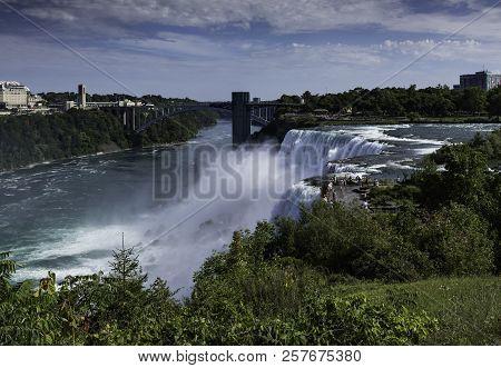 Niagara Falls, Usa - September 3, 2018: View Of American Falls With The Rainbow Bridge On September