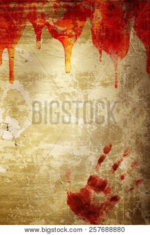 Halloween background.  Drop of blood and print of human palm on stucco wall. Mock up template. Copy space for text