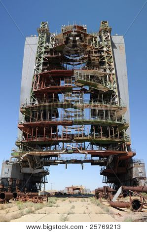 Abandoned mobile service tower at Baikonur cosmodome in Kazakhstan for Soviet Energia rocket and Buran shuttle poster