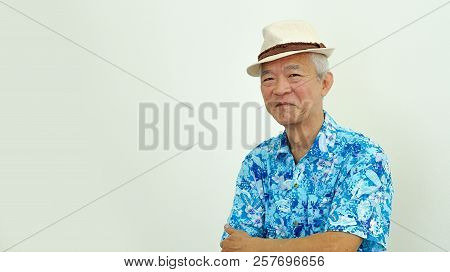 Happy Elderly Asian Man In Hawaii Shirt Ready For Retirement Holiday