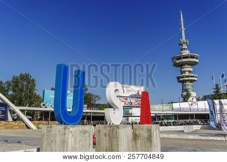 Thessaloniki, Greece - September 10 2018: Entrance To 83rd International Fair With Large Usa Sign. F