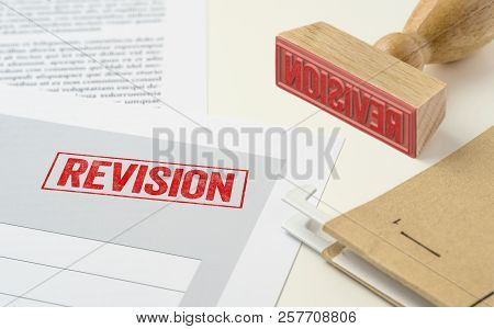 A Red Stamp On A Document - Revision