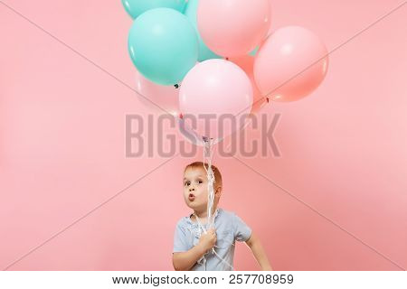 Playful Little Cute Child Baby Boy Holding Bunch Of Colorful Air Balloons, Celebrating Birthday Holi