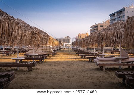 Beautiful Beach With Sun Loungers At Sunset