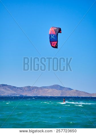 Kos, Greece - July 4, 2018. A Young Man Practicing Kitesurf In A Beach Of The Greek Island Of Kos. S