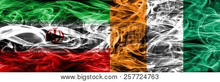 Iran Vs Ivory Coast Smoke Flags Placed Side By Side. Thick Colored Silky Smoke Flags Of Iranian And