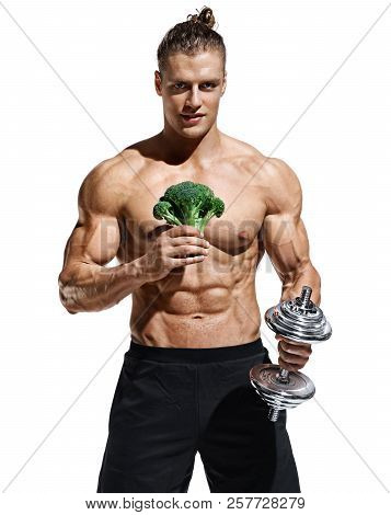 Sporty Man Holding Broccoli And Dumbbell As Symbol Healthy Lifestyle. Photo Of Muscular Man With Nak