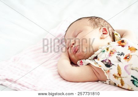 Funny Sweet Caucasian Newborn Baby Sleeping With Her Tongue Out Concept Image.