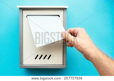 Hand Inserting Letter Envelope Into Mailbox, Mock Up Image For Communication And Correspondence Them