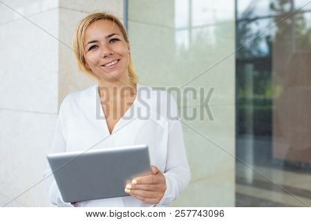 Portrait Of Happy Young Businesswoman Working On Pc Tablet. Caucasian Female Manager Standing At Off