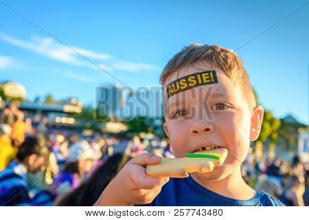 Cute Australian boy with Aussie tattoo on his face on Asutralia Day celebration in Adelaide