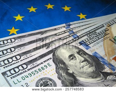 Us Dollars On Background Of Eu Flag. Eurozone, European Economy Concept, Trade And Investment Betwee