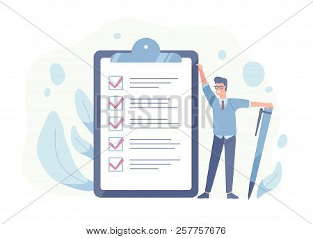 Smiling Guy Standing Beside Giant Check List And Holding Pen. Concept Of Successful Goal Achievement