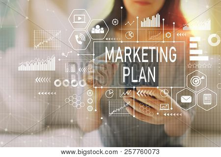 Marketing Plan With Woman Using Her Smartphone On A Couch