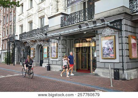 Amsterdam, Netherlands - July 10, 2017: People Walk By Royal Theatre Carre In Amsterdam, Netherlands