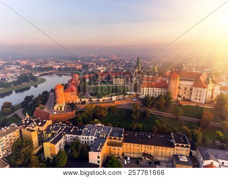 Aerial view Royal Wawel Castle and Gothic Cathedral in Cracow, Poland, with Renaissance Sigismund Chapel with golden dome, fortified walls, yard, park and tourists. poster