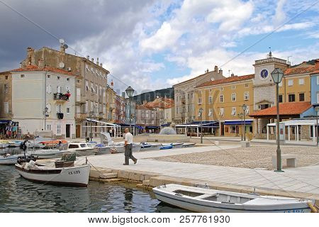 Cres, Croatia - May 17, 2010: Picturesque Buildings And Harbor For Boats In Cres Island, Croatia.