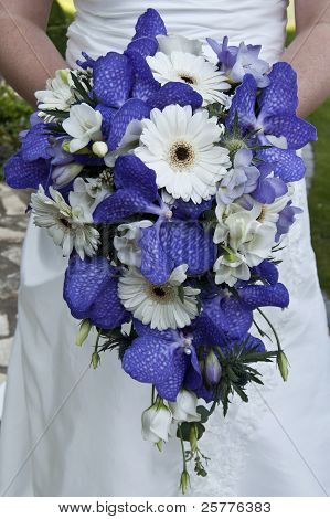 Bride Holding A Beautiful Bouquet Of Flowers