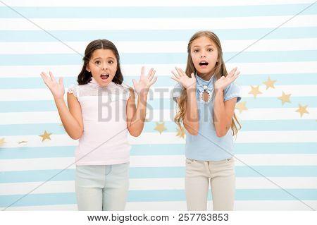 Thrilled moment from childhood. Kids schoolgirls preteens shocked. Girls surprised shocked faces thrilled expression stand striped background. Girls children best friends wonder about surprising news. poster