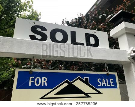 A Sold Sign Outside Of A House That Was On The Market.