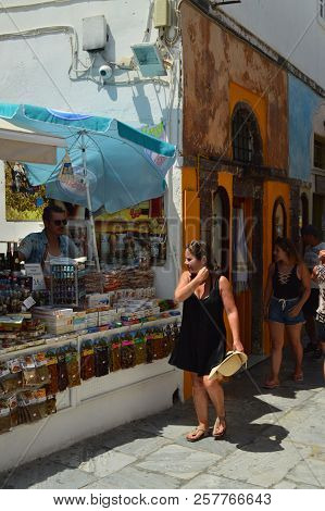 Picturesque Souvenir Shops On The Beautiful Main Street Of Oia On The Island Of Santorini. Architect