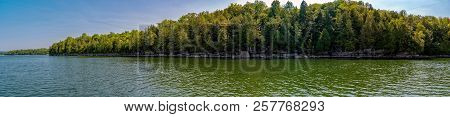 Panoramic View Of Lake Champlain Shore With Trees From A Boat
