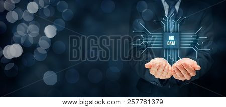 Big Data Analysis Concept. Businessman Or It Specialist With Abstract Symbol Of A Chip With Text Big