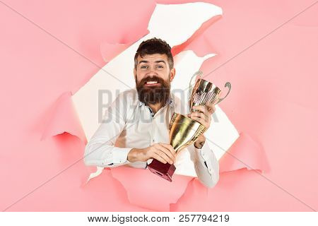 Trophy Winner. Happy Man Making Hole In Paper Hold Golden Cup. Satisfied Man Celebrating Success. Ex