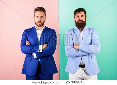 Hide Real Emotions. Business Partners Or Boss And Employee In Suits With Tense Faces. Businessmen Wi
