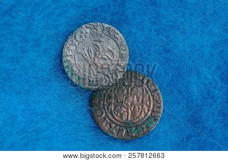 Two Old Rare Silver Coins On Blue Woolen Cloth