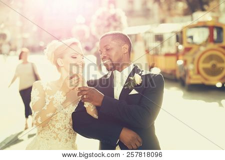 Happy Pretty Girl Or Cute Bride With Beautiful Blond Hair In White Sexy Wedding Dress And Handsome M