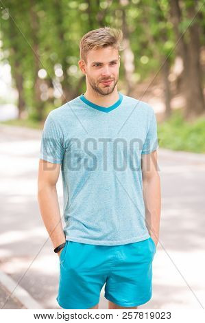 Enjoy wellbeing and healthy body. Man sporty outfit looks confident outdoors nature background. Guy bearded muscular body proud of his sporty shape. Sportsman muscular body ready for morning run. poster