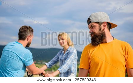 Man Hipster Feels Lonely Couple Dating Behind Him. No Romantic In His Life. Man Regret Not Asked Her