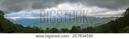 Early Sunset Light Breaks Through Clouds Over Blue Ridge Mountains Panorama