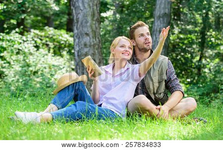 Couple In Love Spend Leisure In Park Or Forest. Romantic Couple Students Enjoy Leisure Looking Upwar