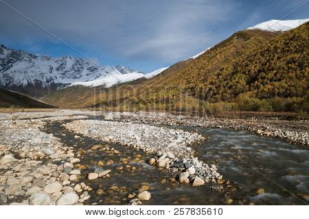 Samegrelo-zemo svaneti autumn. Enguri river and Shhara mountain, Georgia. Landscape with Main Caucasian ridge