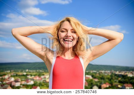 Girl Pleased With Warm Sunlight Looks Relaxed Blue Sky Background. Woman Blonde Relaxing Outdoors. T