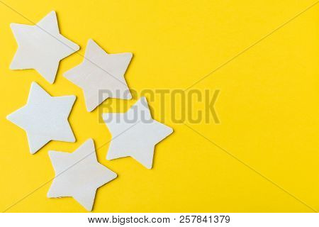Customer Reviews Or Cx, Custome Experience Concept, 5 Wooden Stars On Solid Yellow Background With C