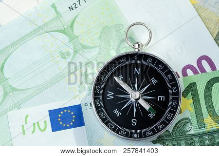 Europe Economy Direction, Financial, Investment Or Impact Of Brexit Concept, Compass Put Beside Euro