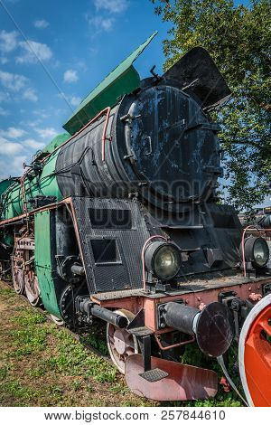 An old disused retro steam train locomotive on the side track poster