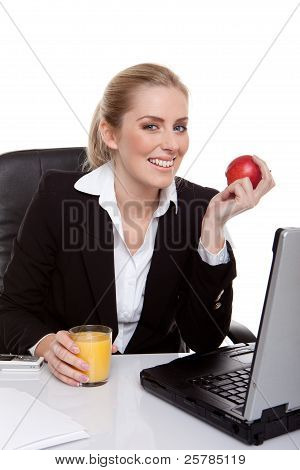 woman eating apple and drinking orange juice