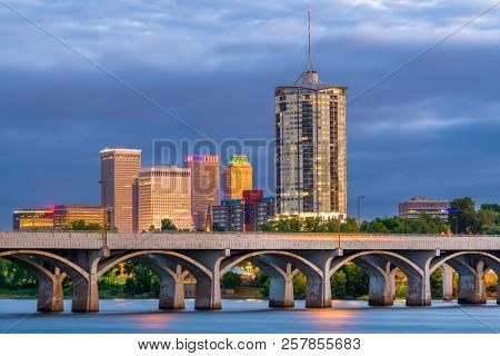 Tulsa, Oklahoma, USA downtown skyline on the Arkansas River at dusk.